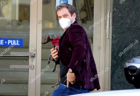 Stock Image of Tomaso Trussardi returns to work after celebrating his 38th  birthday seen here with his greyhound Odino