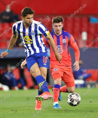 Porto's Marko Grujic kicks the ball ahead of Chelsea's Mason Mount during the Champions League, first leg, quarterfinal soccer match between FC Porto and Chelsea at the Ramon Sanchez-Pizjuan stadium in Seville, Spain
