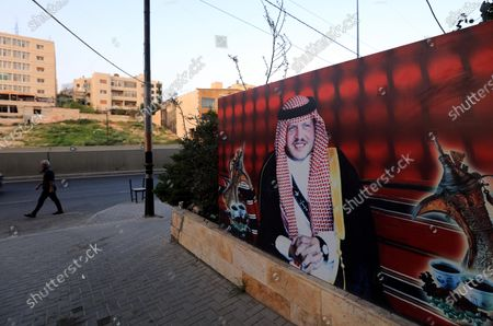 """A man walks by a poster depicting King Abdullah II bin Al-Hussein, King of Jordan, at a street of Amman, Jordan, 07 April 2021. King Abdullah II of Jordan addressed the Jordanians on 07 April, through a statement read on the news, he talked about the recent developments, following an alleged plot, the detention of several senior figures and arift involving his half brother Prince Hamzah bin Hussein. The king announced the end of the crisis and said that Prince Hamza, is """"with his family at his palace, under my care,"""
