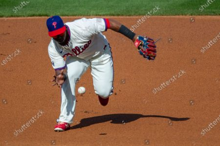 Stock Image of Philadelphia Phillies shortstop Jean Segura fields a grounder by New York Mets Brandon Nimmo (9) during the first inning of a baseball game, in Philadelphia