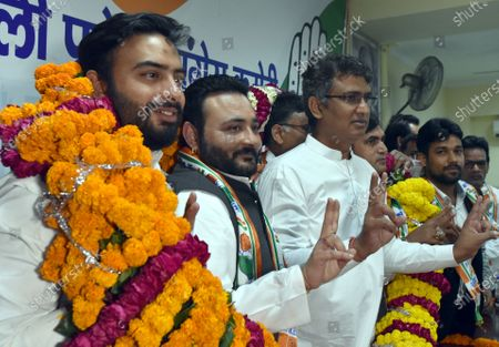Stock Image of DPCC president Ch. Anil Kumar welcomes Join the congress Party prominent Poorvanchali leaders of NCP Rana Sujit Singh, and JDU and Aam Aadmi Party into Delhi Congress at at the DPCC office, Rajiv Bhawan in New Delhi, India on Wednesday. April 7, 2021,