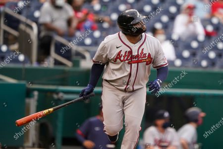 Atlanta Braves' Pablo Sandoval watches his two-run homer during the seventh inning of the second baseball game of a doubleheader against the Washington Nationals, at Nationals Park, in Washington.The Braves won the second game 2-0