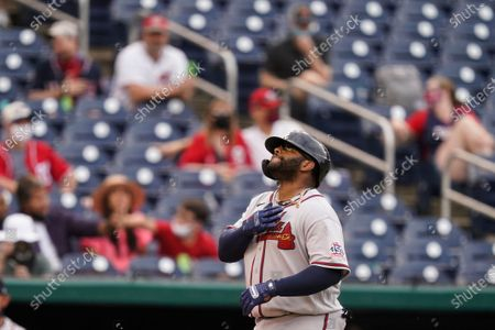 Atlanta Braves' Pablo Sandoval celebrates as he rounds the bases for his two-run homer during the seventh inning of the second baseball game of a doubleheader against the Washington Nationals, at Nationals Park, in Washington.The Braves won the second game 2-0