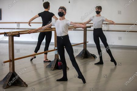 Dancers Zane Tahvildaran-Jesswein, 12, left, of Santa Monica, Sawyer Jordan, 14, middle, of Santa Monica and Jesse Peterson, 14, right, of Santa Monica, practice during an advanced pre-professional class at West Side Ballet of Santa Monica on Thursday, April 1, 2021 in Santa Monica, CA. The city of Santa Monica has now allowed dance classes to open at 10 percent capacity during the coronavirus pandemic.