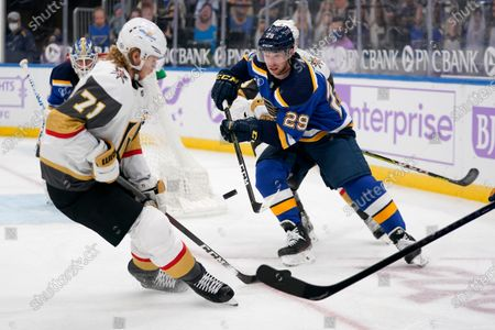 St. Louis Blues' Vince Dunn (29) controls the puck as Vegas Golden Knights' William Karlsson (71) defends during the third period of an NHL hockey game, in St. Louis