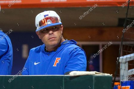 Stock Image of Florida coach Kevin O'Sullivan watches the team's NCAA college baseball game against Florida A&M, in Gainesville, Fla