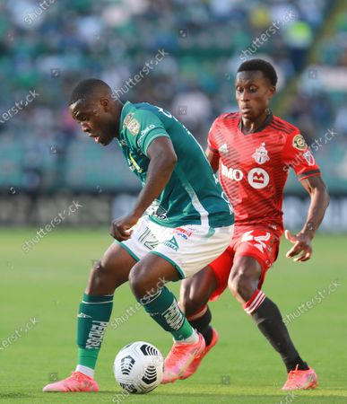 Joel Campbell (L) of Leon plays the ball with Richie Laryea (R) of Toronto FC, during the CONCACAF Champions League soccer match between Leon and Toronto FC at the Leon Stadium, in Leon, Mexico, 07 April 2021.
