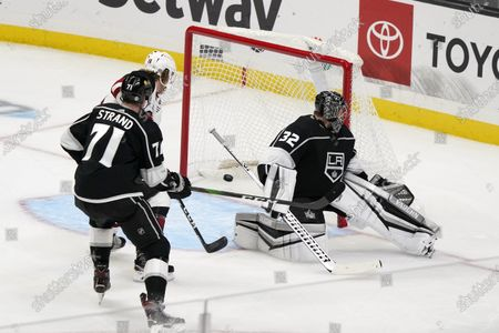 Los Angeles Kings goaltender Jonathan Quick (32) gives up a goal on a shot from Arizona Coyotes' Ilya Lyubushkin, not seen, during the first period of an NHL hockey game, in Los Angeles
