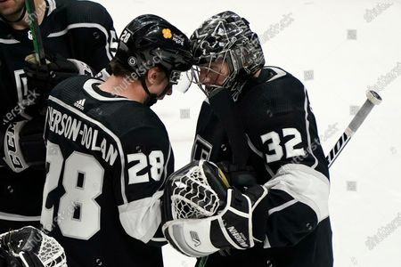 Los Angeles Kings goaltender Jonathan Quick (32) celebrates with Jaret Anderson-Dolan (28) after the team's win over the Arizona Coyotes in an NHL hockey game, in Los Angeles
