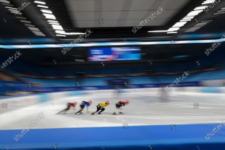 Stock Photo of Chinese skaters compete in the men's 1000 meters short track speed skating race during a test event for the 2022 Beijing Winter Olympics at the Capital Indoor Stadium in Beijing, . The organizers of the 2022 Beijing Winter Olympics has started 10 days of testing for several sport events in five different indoor venues from April 1-10, becoming the first city to hold both the Winter and Summer Olympics