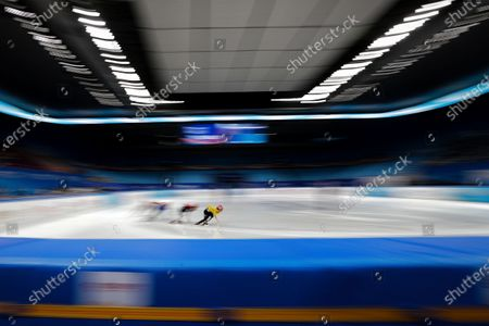 Stock Image of Chinese skaters compete in the men's 1000 meters short track speed skating race during a test event for the 2022 Beijing Winter Olympics at the Capital Indoor Stadium in Beijing, . The organizers of the 2022 Beijing Winter Olympics has started 10 days of testing for several sport events in five different indoor venues from April 1-10, becoming the first city to hold both the Winter and Summer Olympics