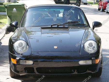 Kendall Jenner in a vintage Porsche Carrera in West Hollywood