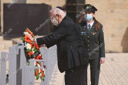 Israeli President Reuven Rivlin, left, attends a wreath-laying ceremony marking the Holocaust Remembrance Day at Warsaw Ghetto Square in Jerusalem's Yad Vashem memorial