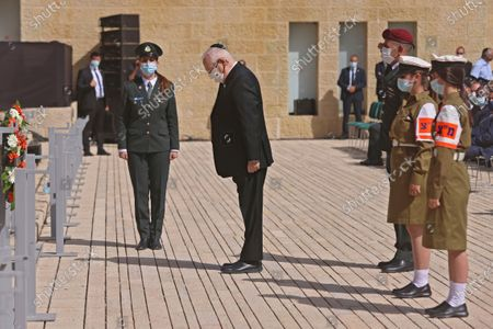 Israeli President Reuven Rivlin, center, attends a wreath-laying ceremony marking the Holocaust Remembrance Day at Warsaw Ghetto Square at Yad Vashem, the world Holocaust remembrance center in Jerusalem