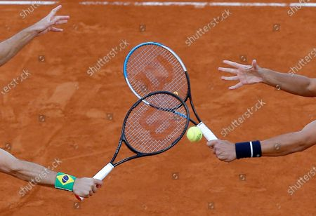 Dated, Croatia's Mate Pavic, right, and Brazil's Bruno Soares play a shot in the men's doubles final match of the French Open tennis tournament at the Roland Garros stadium in Paris, France. The 2021 French Open schedule is being disrupted by the coronavirus pandemic for the second year in a row, as organizers said Thursday April 8, 2021, the Grand Slam tournament will be delayed by one week because of surging virus cases in France