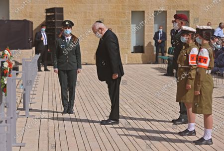 Israeli President Reuven Rivlin awaits a wreath-testing the Holocaust Remembrance Day at Warsaw Ghetto Square in Jerusalem's Yad Vashem memorial on April 8, 2021.