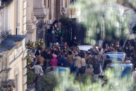 Lady Gaga, wearing a wedding dress in background left, plays Maurizio Gucci's former wife Patrizia Reggiani during the shooting of a movie by Ridley Scott, based on the story of the murder of Maurizio Gucci in 1995, in Rome