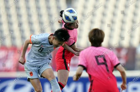 Stock Picture of Ma Jun of China and Lee Young-ju of South Korea duel for the ball in the air during the Women's Olympic Football Tournament Playoff between Korea Republic and China at the Goyang Stadium in Goyang, South Korea, on April 08, 2021.