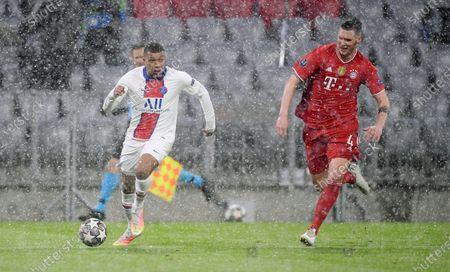 Kylian Mbappe #7 (Paris Saint-Germain) and Niklas Suele #4 (FC Bayern Munich)