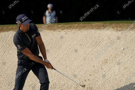 Henrik Stenson, of Sweden, hits out of a bunker on the fourth hole during the first round of the Masters golf tournament, in Augusta, Ga