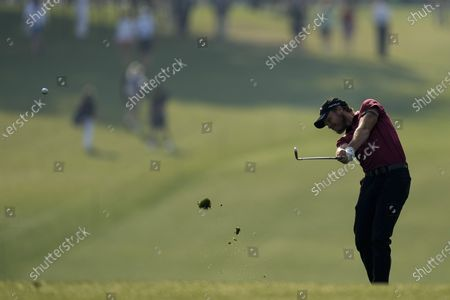 Danny Willet, of England, hits from the first fairway during the first round of the Masters golf tournament, in Augusta, Ga