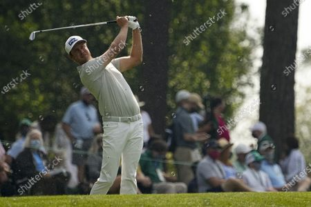 Harris English watches his tee shot on the fourth hole during the first round of the Masters golf tournament, in Augusta, Ga
