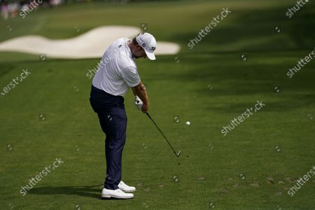 Webb Simpson tees off on the sixth hole during the first round of the Masters golf tournament, in Augusta, Ga