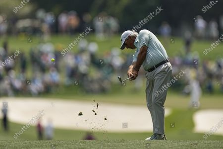 Stock Picture of Fred Couples hits from the first fairway during the first round of the Masters golf tournament, in Augusta, Ga