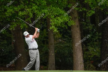 Jose Maria Olazabal, of Spain, watches his shot on the 11th fairway during the first round of the Masters golf tournament, in Augusta, Ga