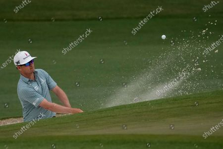 Zach Johnson hits out of a bunker on the 17th hole during the first round of the Masters golf tournament, in Augusta, Ga