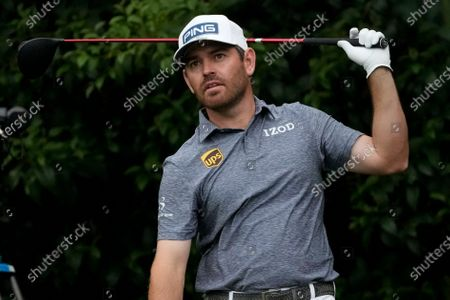 Louis Oosthuizen, of South Africa, watches his tee shot on the 14th hole during the first round of the Masters golf tournament, in Augusta, Ga