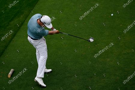 Zach Johnson tees off on the 18th hole during the first round of the Masters golf tournament, in Augusta, Ga