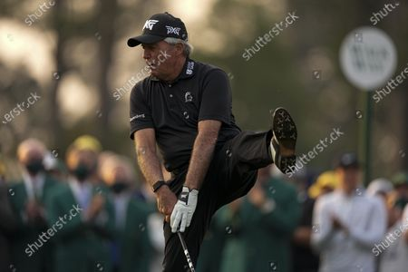 Gary Player kicks up his leg after hitting a ceremonial first tee shot during the first round of the Masters golf tournament, in Augusta, Ga