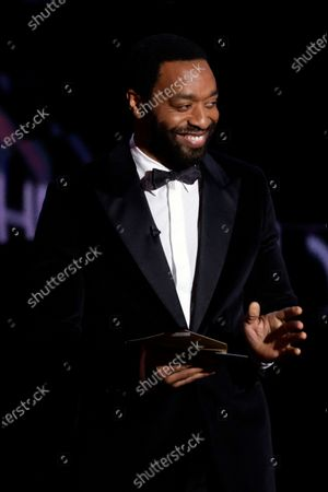 Chiwetel Ejiofor presents the Best Film award