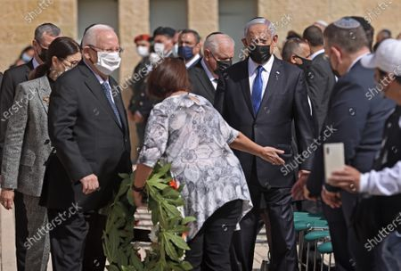 Israeli President Reuven Rivlin (L) and Prime Minister Benjamin Netanyahu attend a wreath-laying ceremony marking the Holocaust Remembrance Day at Warsaw Ghetto Square in Jerusalem's Yad Vashem memorial on Thursday, April 8, 2021.