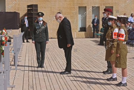 Israeli President Reuven Rivlin attends a wreath-laying ceremony marking the Holocaust Remembrance Day at Warsaw Ghetto Square in Jerusalem's Yad Vashem memorial on Thursday, April 8, 2021.