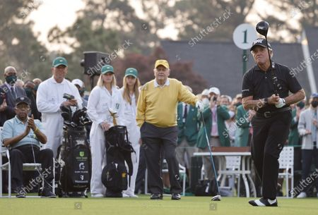 Honorary starting golfer Gary Player (R) tees off at the first tee to start the first round of the 2021 Masters Tournament at the Augusta National Golf Club in Augusta, Georgia, USA, 06 April 2021. The 2021 Masters Tournament is held 08 April through 11 April 2021.