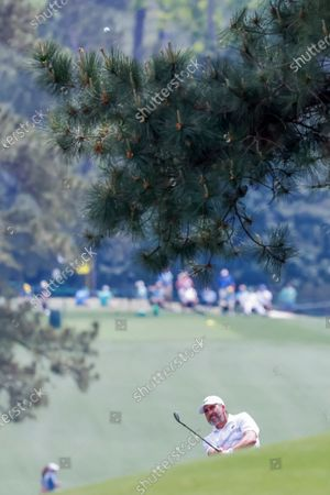 Jose Maria Olazabal of Spain hits over a pine tree on the eighth fairway during the first round of the 2021 Masters Tournament at the Augusta National Golf Club in Augusta, Georgia, USA, 08 April 2021.