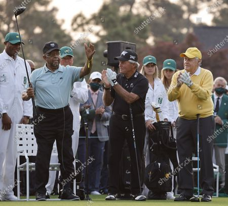 Honorary starting golfer Lee Elder (L) is acknowledged by the crowds along with Gary Player (C) and Jack Nicklaus (R) at the start of the first round of the 2021 Masters Tournament at the Augusta National Golf Club in Augusta, Georgia, USA, 06 April 2021. The 2021 Masters Tournament is held 08 April through 11 April 2021.