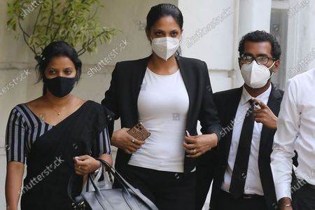 Stock Picture of Mrs. World Caroline Jurie (C) flanked by her lawyers walk out of the Cinnamon Gardens Police station after being enlarged on police bail in Colombo, Sri Lanka, 08 April 2021. Reigning Mrs. World Caroline Jurie and model and catwalk trainer Chula Padmendra were arrested by the Cinnamon Gardens Police earlier today 08 April on three separate counts, following a complaint filed by Pushpika De Silva who won the Mrs. Sri Lanka 2020 title during a pageant at the Nelum Pokuna Theatre in Colombo.  Jurie who was among the panel of judges declared that she takes the first step to disqualify  De Silva as she is a divorcee, removed the crown and declared the runner-up as the winner. De Silva claimed that she is not divorced but in fact is only separated and thus is qualified and lodged a complaint that she was injured while the crown was being removed hastily. The next day, the organisers of the pageant took steps to restore the crown on Ms. Pushpika De Silva and requested Jurie to apologies for the ugly incident.