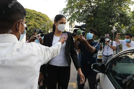 Mrs. World Caroline Jurie (C) walks out of the Cinnamon Gardens Police station after being enlarged on police bail in Colombo, Sri Lanka, 08 April 2021. Reigning Mrs. World Caroline Jurie and model and catwalk trainer Chula Padmendra were arrested by the Cinnamon Gardens Police earlier today 08 April on three separate counts, following a complaint filed by Pushpika De Silva who won the Mrs. Sri Lanka 2020 title during a pageant at the Nelum Pokuna Theatre in Colombo.  Jurie who was among the panel of judges declared that she takes the first step to disqualify  De Silva as she is a divorcee, removed the crown and declared the runner-up as the winner. De Silva claimed that she is not divorced but in fact is only separated and thus is qualified and lodged a complaint that she was injured while the crown was being removed hastily. The next day, the organisers of the pageant took steps to restore the crown on Ms. Pushpika De Silva and requested Jurie to apologies for the ugly incident.