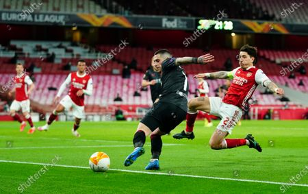 Hector Bellerin of Arsenal jumps in an attempt to block a cross from Nicolae Stanciu of Slavia Prague