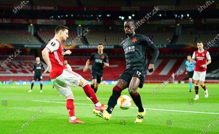 Stock Image of Cedric Soares of Arsenal battles with Abdallah Sima of Slavia Prague