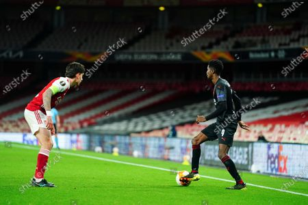 Peter Olayinka of Slavia Prague showboats in front of Hector Bellerin of Arsenal - sequence 5 of 5