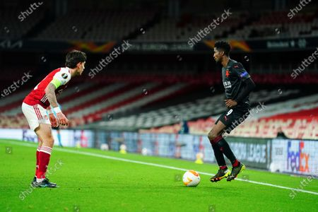 Peter Olayinka of Slavia Prague showboats in front of Hector Bellerin of Arsenal - sequence 3 of 5