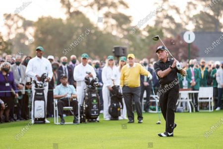 Gary Player hits a ceremonial tee shot as Jack Nicklaus and Lee Elder, the first Black man to play the Masters Tournament, watch at the start the 2021 Masters Tournament at the Augusta National Golf Club in Augusta, Georgia on Thursday, April 8, 2021. Photo by Kevin Dietsch/UPI