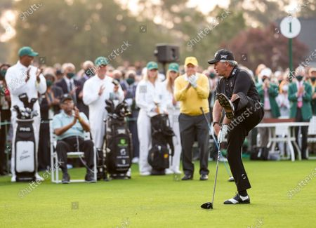 Gary Player kicks his foot after hitting a ceremonial tee shot as Jack Nicklaus and Lee Elder, the first Black man to play the Masters Tournament, watch at the start the 2021 Masters Tournament at the Augusta National Golf Club in Augusta, Georgia on Thursday, April 8, 2021. Photo by Kevin Dietsch/UPI