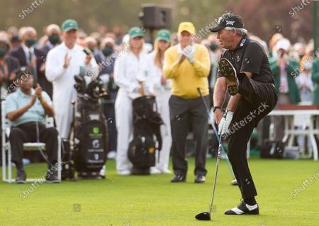 Stock Image of Gary Player kicks his foot after hitting a ceremonial tee shot as Jack Nicklaus and Lee Elder, the first Black man to play the Masters Tournament, watch at the start the 2021 Masters Tournament at the Augusta National Golf Club in Augusta, Georgia on Thursday, April 8, 2021. Photo by Kevin Dietsch/UPI