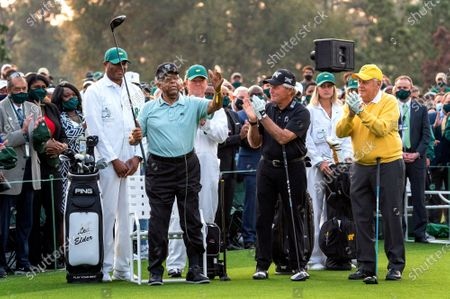 Lee Elder, the first Black man to play in the Masters, is honored as Gary Player (C) and Jack Nicklaus (R) applaud, before hitting the honorary tee shots to start the 2021 Masters Tournament at the Augusta National Golf Club in Augusta, Georgia on Thursday, April 8, 2021.