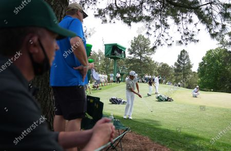 Harris English chips to the green on the fourteenth hole during the first round of the 2021 Masters Tournament at Augusta National Golf Club in Augusta, Georgia on Thursday, April 8, 2021.